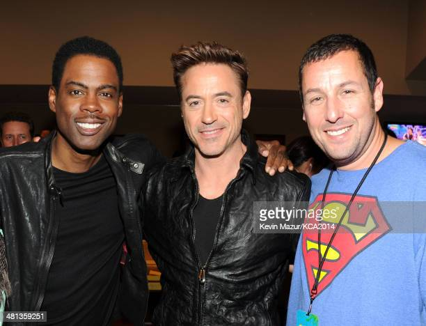 Actors Chris Rock Robert Downey Jr and Adam Sandler attend Nickelodeon's 27th Annual Kids' Choice Awards held at USC Galen Center on March 29 2014 in...