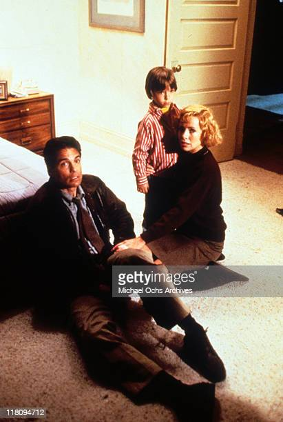 Actors Chris Sarandon and Catherine Hicks with child actor Alex Vincent in a scene from the film 'Child's Play' 1988