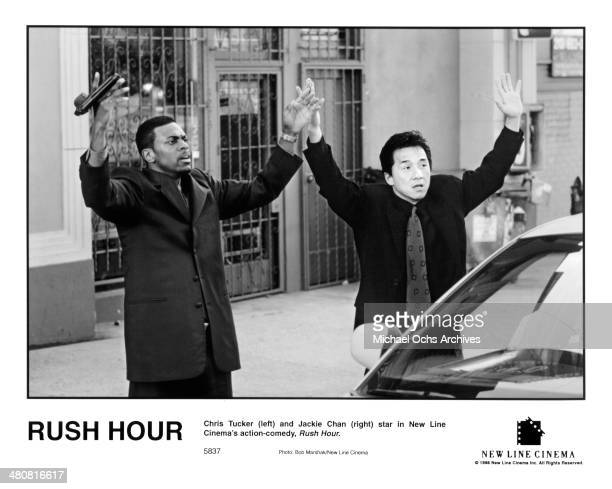 Actors Chris Tucker and Jackie Chan give up in a scene of the New Line Cinema movie Rush Hour circa 1998