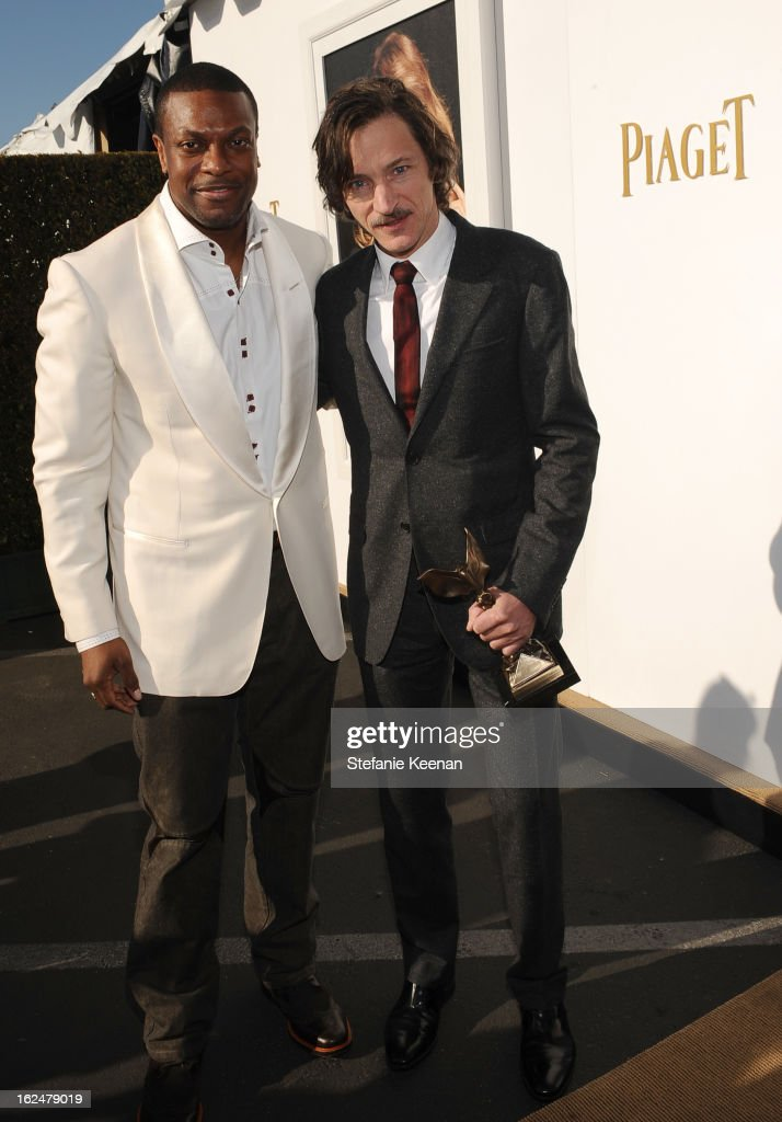 Actors Chris Tucker and John Hawkes poses in the Piaget Lounge during The 2013 Film Independent Spirit Awards on February 23, 2013 in Santa Monica, California.