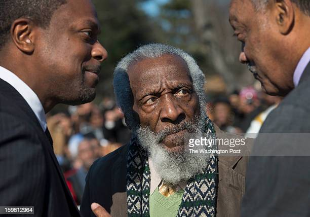 Actors Chris Tucker Dick Gregory with Rev Jesse Jackson at the WreathLaying Ceremony at the Martin Luther King Jr Memorial in Washington DC on...