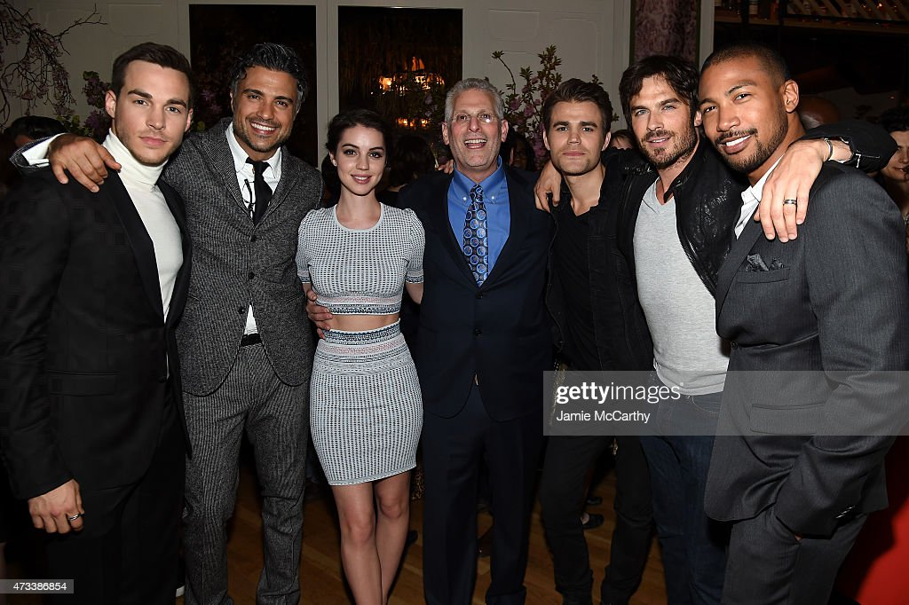 Actors Chris Wood, Jaime Camil, Adelaide Kane, Mark Pedowitz, President of The CW Network, Paul Wesley, Ian Somerhalder and Charles Michael Davis attend the CW Network's 2015 Upfront party at Park Avenue Spring on May 14, 2015 in New York City.