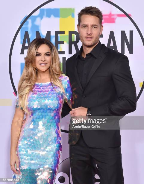 Actors Chrishell Stause and Justin Hartley arrive at the 2017 American Music Awards at Microsoft Theater on November 19 2017 in Los Angeles California