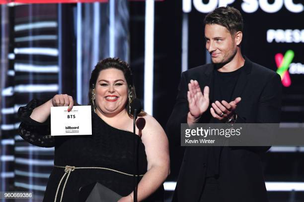 Actors Chrissy Metz and Justin Hartley display an evelope naming music group BTS the winners of the Top Social Artist award onstage during the 2018...