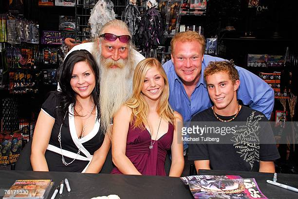 Actors Christa Campbell Amy Baniecki and Ryan Fleming musician Johnny Legend and director Tim Sullivan pose at an autograph party for the new graphic...
