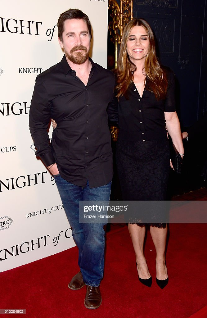 Actors Christian Bale (L) and Sibi Blazic arrive at the Premiere Of Broad Green Pictures' 'Knight Of Cups' at the Theatre at Ace Hotel on March 1, 2016 in Los Angeles, California.