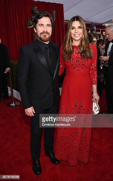 Actors Christian Bale and Sibi Blazic attend The 22nd Annual Screen Actors Guild Awards at The Shrine Auditorium on January 30 2016 in Los Angeles...
