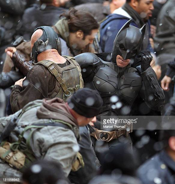 Actors Christian Bale in costume as Batman and Tom Hardy as Bane are seen on the set of 'The Dark Knight Rises' on location on Wall Street on...