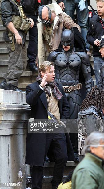 Actors Christian Bale in costume as Batman Tom Hardy as Bane and director Christopher Nolan are seen on the set of The Dark Knight Rises on location...