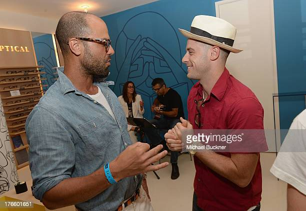 Actors Christian George and Jonny Abrahams attend Warby Parker's store opening in The Standard Hollywood on August 15 2013 in Los Angeles California