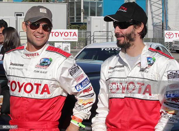 Actors Christian Slater and Keanu Reeves pose for photographers during the press practice day for the Toyota Pro/Celebrity Race on April 6 2010 in...