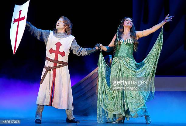 Actors Christian Slater and Merle Dandridge perform onstage during Monty Python Spamalot at the Hollywood Bowl on July 31 2015 in Hollywood California