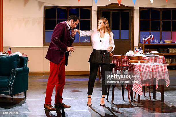 Actors Christian Vadim and Vanessa Demouy perform in the 'L'appel de Londres' play at the 30th Ramatuelle Festival Day 8 on August 8 2014 in...