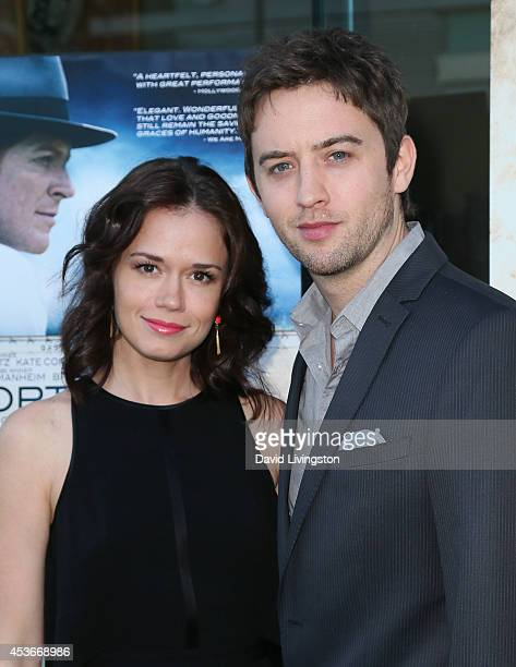 Actors Christie Burson and Johnny Pacar attend the premiere of Fort McCoy at Laemmle's Music Hall 3 on August 15 2014 in Beverly Hills California
