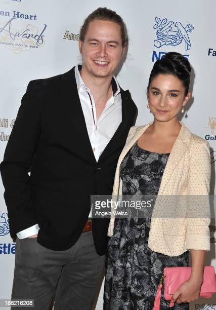 Actors Christoph Sanders and Molly Ephraim arrive at the Midnight Mission Golden Heart Awards 2013 at the Beverly Wilshire Four Seasons Hotel on May...