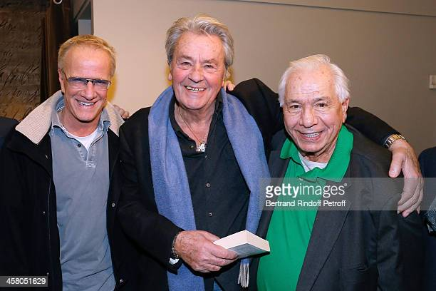 Actors Christophe Lambert Alain Delon and Michel Galabru pose backstage following the show of impersonator Laurent Gerra 'Un spectacle Normal' at...