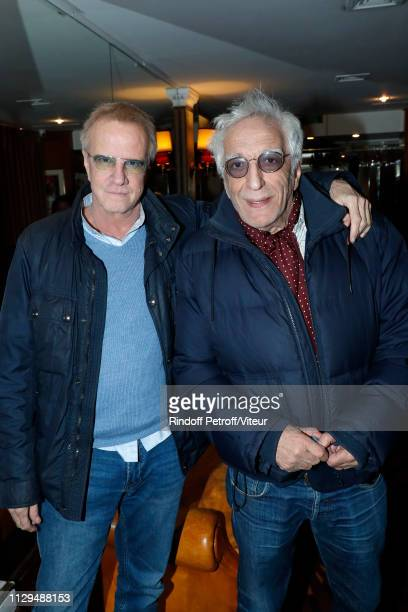 Actors Christophe Lambert and Gerard Darmon attend Claude Lelouch receives the Insignia of Officer of the Legion of Honor at Club 13 on February 13...