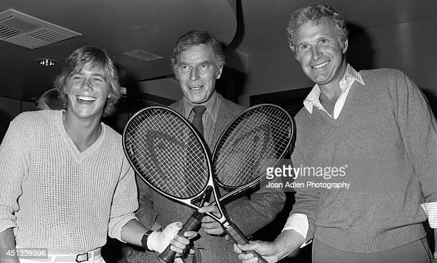 Actors Christopher Atkins Charlton Heston and Wayne Rogers at a party honoring Heston as the host of a tennis tournament benefiting the American Film...