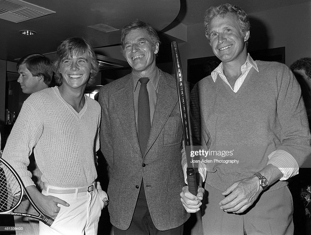 Actors Christopher Atkins, Charlton Heston and Wayne Rogers at a party honoring Heston as the host of a tennis tournament benefiting the American Film Institute, on June 17, 1982 in Los Angeles, California.