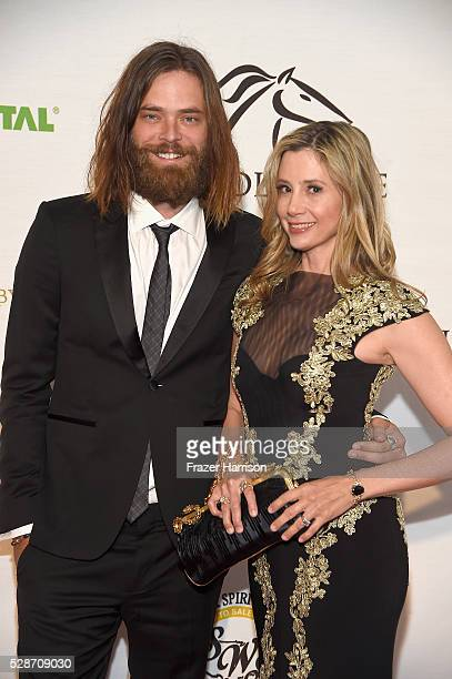 Actors Christopher Backus and Mira Sorvino attend Unbridled Eve Gala during the 142nd Kentucky Derby on May 6 2016 in Louisville Kentucky