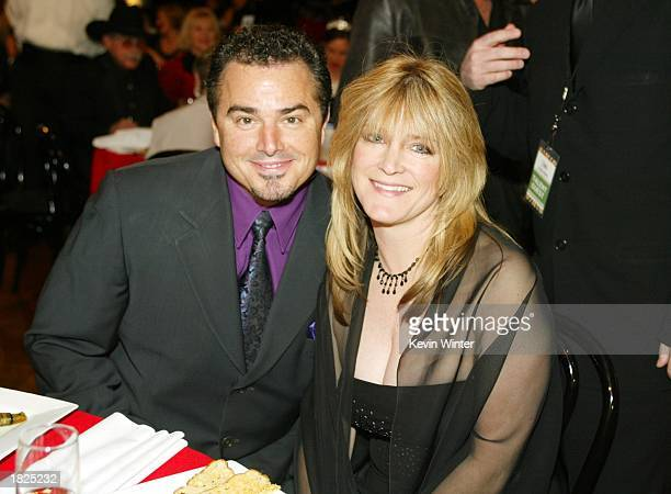 Actors Christopher Knight and Susan Olsen pose during the TV Land Awards 2003 at the Hollywood Palladium on March 2 2003 in Hollywood California