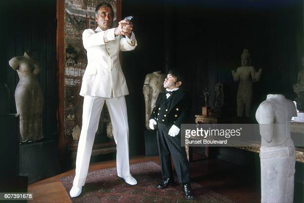 Actors Christopher Lee and Herve Villechaise on the set of 'The Man With The Golden Gun'