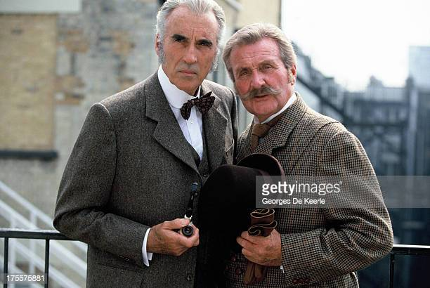 Actors Christopher Lee and Patrick Macnee pose on a shoot for the TV movie 'Sherlock Holmes and the Leading Lady' on 1991 ca. In London, England.