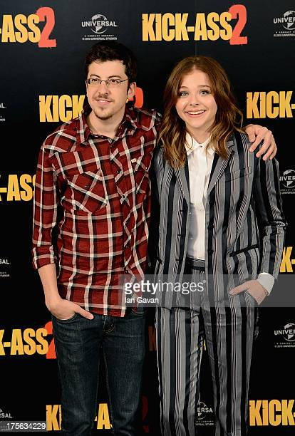 Actors Christopher Mintz Plasse and Chloe Grace Moretz attend the 'KickAss 2' Photocall at Claridges Hotel on August 5 2013 in London England