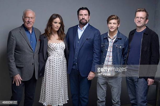 Actors Christopher Plummer Abigail Spencer John Travolta Tye Sheridan and director Philip Martin of 'The Forger' pose for a portrait during the 2014...