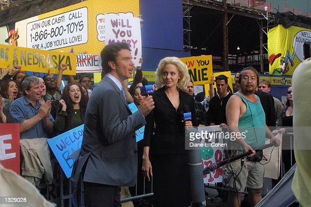 Actors Christopher Shyer and Angelina Jolie film a scene on the set of the movie 'Life or Something Like It' June 30 2001 in Times Square in New York...