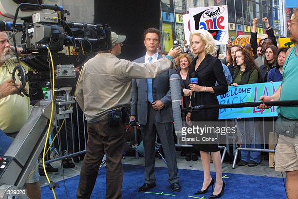 Actors Christopher Shyer center left and Angelina Jolie prepare to film a scene on the set of the movie 'Life or Something Like It' June 30 2001 in...