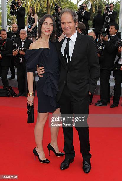 Actors Christopher Thompson and Geraldine Pailhas attend the premiere of 'Poetry' held at the Palais des Festivals during the 63rd Annual...