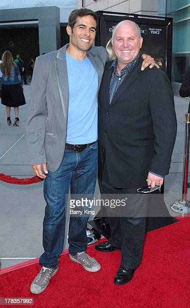 Actors Christopher Wolfe and James DuMont attend the premiere of 'Dark Tourist' at ArcLight Hollywood on August 14 2013 in Hollywood California