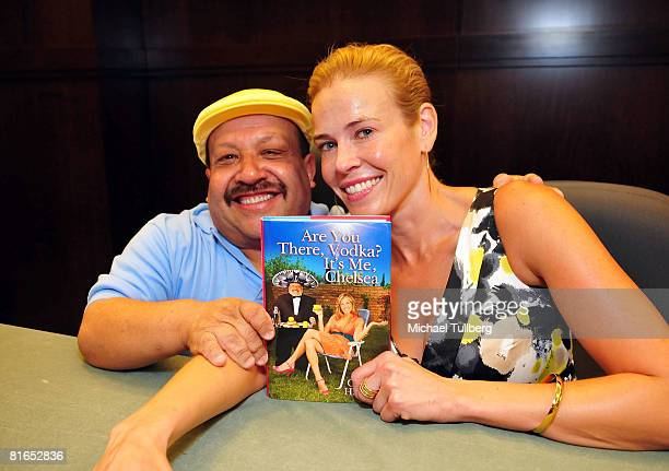 "Actors Chuy Bravo and Chelsea Handler pose with her Handler's book ""Are You There, Vodka? It's Me, Chelsea"", at a signing of her book at the Barnes &..."