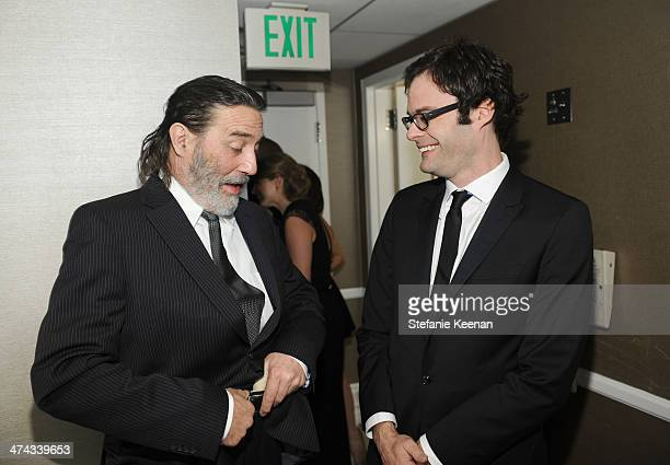 Actors Ciarán Hinds and Bill Hader attend the 16th Costume Designers Guild Awards with presenting sponsor Lacoste at The Beverly Hilton Hotel on...