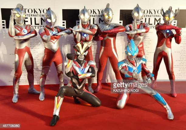 Actors clad in body suits of Ultrman series characters pose on the red carpet for the 27th Tokyo International Film Festival opening ceremony in...