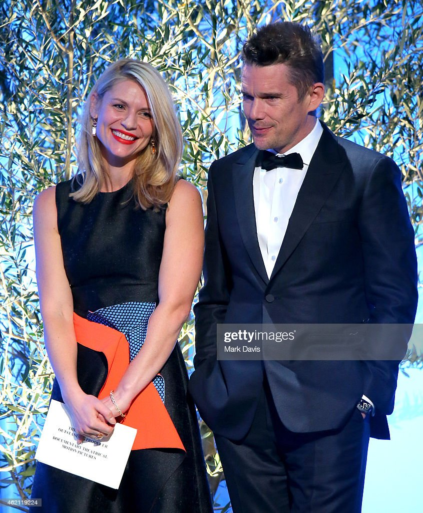 Actors Claire Danes (L) and Ethan Hawke speak onstage during the 26th Annual Producers Guild Of America Awards at the Hyatt Regency Century Plaza on January 24, 2015 in Los Angeles, California.