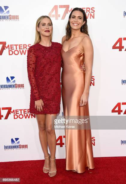 Actors Claire Holt and Mandy Moore attend the Premiere Of Dimension Films' '47 Meters Down' at Regency Village Theatre on June 12 2017 in Westwood...