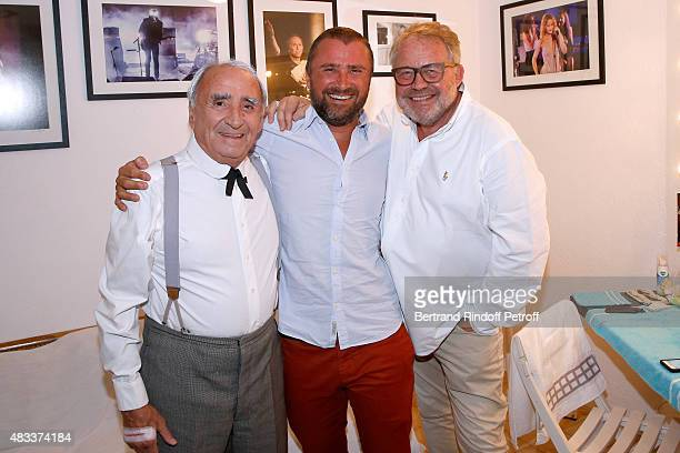 Actors Claude Brasseur, his son Alexandre Brasseur and Dominique Segall attend the 'La colere du Tigre' Theater play during the 31th Ramatuelle...