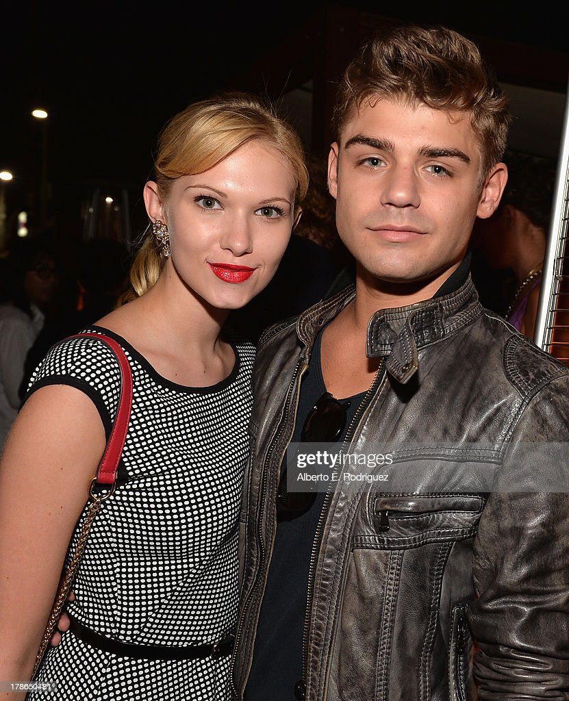 Actors Claudia Lee and Garrett Clayton attend Genlux Magazine's Issue Release party featuring Erika Christensen at The Sofitel Hotel on August 29, 2013 in Los Angeles, California.