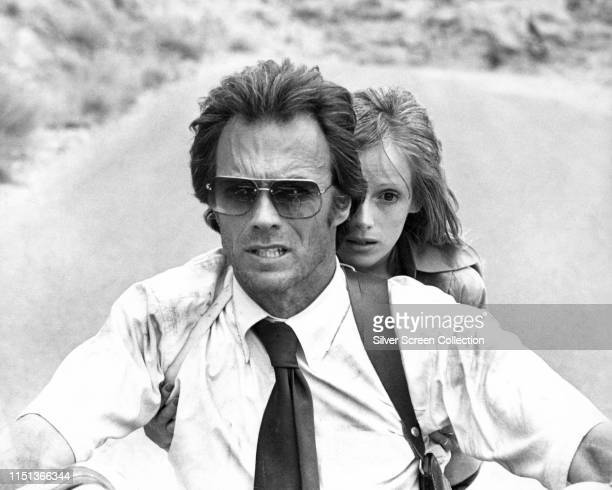 Actors Clint Eastwood as Ben Shockley and Sondra Locke as Gus Mally on a motorcycle in the film 'The Gauntlet' 1977