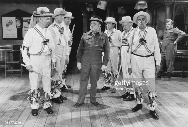 Actors Clive Dunn Ian Lavender Unknown Arthur Lowe Unknown Arnold Ridley and John Laurie dressed as morris dancers in a scene from episode 'The...