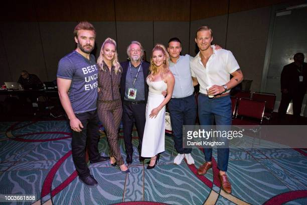 Actors Clive Standen Georgia Hirst creator/writer Michael Hirst actors Katheryn Winnick Alex Hogh Andersen and Alexander Ludwig of Vikings pose...