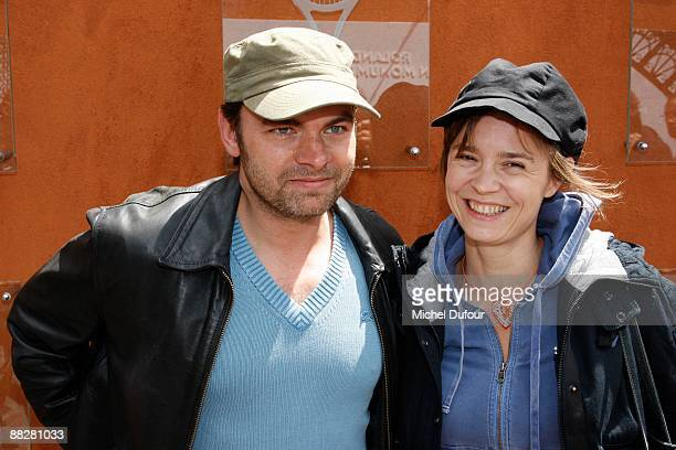 Actors Clovis Cornillac and Caroline Proust are seen during the French Open at Stade Roland Garros on June 7 2009 in Paris France