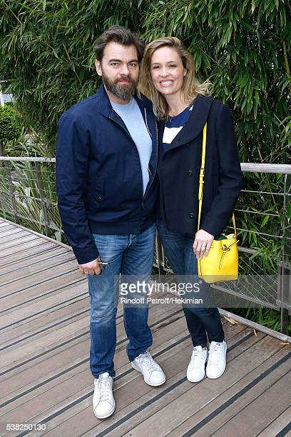 Actors Clovis Cornillac and his wife Lilou Fogli attend Day Fifteen Men single's Final of the 2016 French Tennis Open at Roland Garros on June 5 2016...