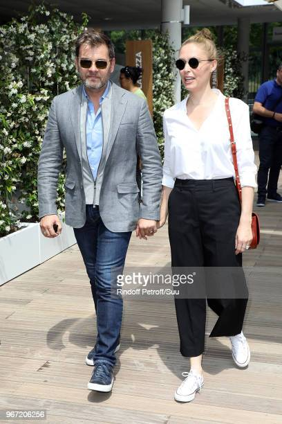 Actors Clovis Cornillac and his wife Lilou Fogli attend the 2018 French Open Day Nine at Roland Garros on June 4 2018 in Paris France