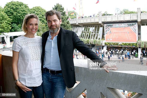 Actors Clovis Cornillac and his wife Lilou Fogli attend the 'France Television' Lunch during Day Seven of the 2016 French Tennis Open at Roland...