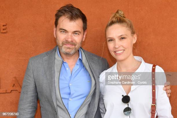 Actors Clovis Cornillac and Lilou Fogli attend the 2018 French Open Day Nine at Roland Garros on June 4 2018 in Paris France