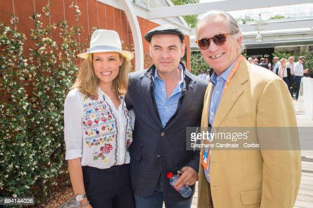 Actors Clovis Cornillac Lilou Fogli and William Leymergie attend the French Tennis Open 2017 Day Thirteen at Roland Garros on June 9 2017 in Paris...