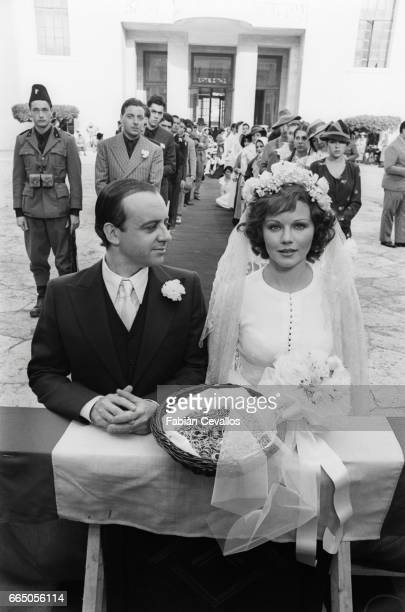 Actors Cochi Ponzoni and Agostina Belli as the characters Roberto and Marcella Valmarin appear in a wedding scene from the 1976 Italian film Telefoni...